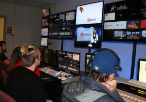 Students work in the control room during a live show.